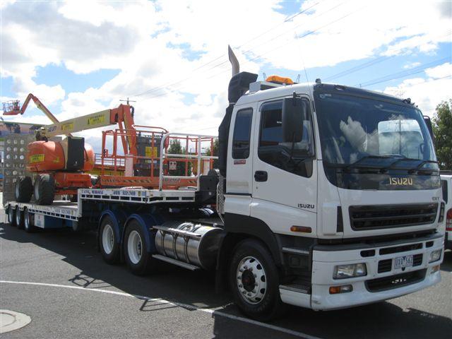 transport podnośników, maszyn budowlanych, koparek, ładowarek